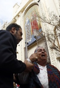 An Egyptian Christian woman grieves for a relative killed during Saturday's bomb attack at the Coptic Orthodox church in Alexandria