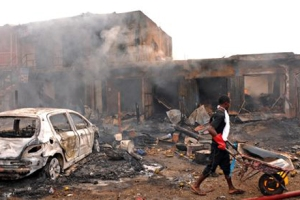 Wreckage of burnt vehicle after blasts at Terminus market in Jos, Nigeria