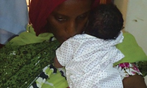 Meriam Ibrahim with her daughter, who was born in Omdurman women's prison last week