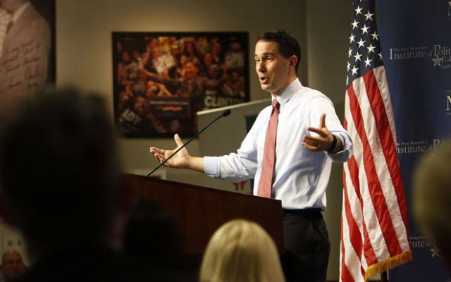 Republican presidential candidate, Wisconsin Gov. Scott Walker speaks during a campaign stop called Politics and Eggs with business leaders and political activist, Friday, Aug. 21, 2015, in Manchester, N.H. (AP Photo/Jim Cole) ORG XMIT: NHJC106