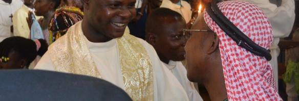 Catholic priest greeting Muslim leader after prayers
