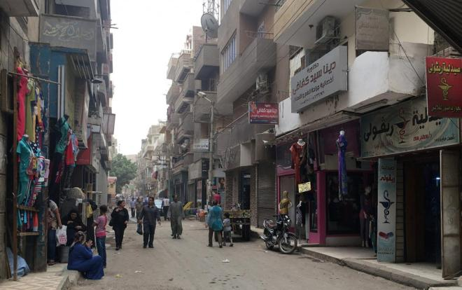 People walk on a street in Egypt's Southern governorate of Minya