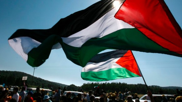 Israeli Arabs wave Palestinian flags during a rally to mark the Nakba in Megiddo