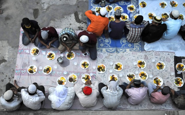 Muslim Taking Iftar To Break Their Fast